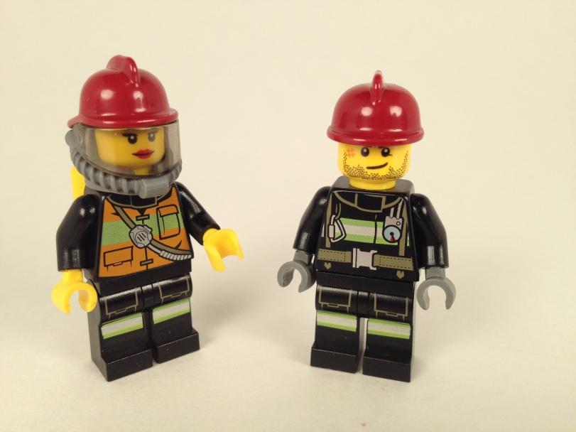 Her lipstick matches her fire helmet. He needs a shave.
