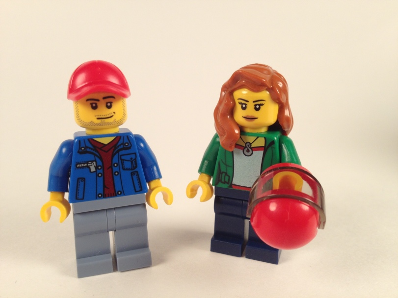 Female minifig torso is unique to the set, and she's immune to helmet hair.